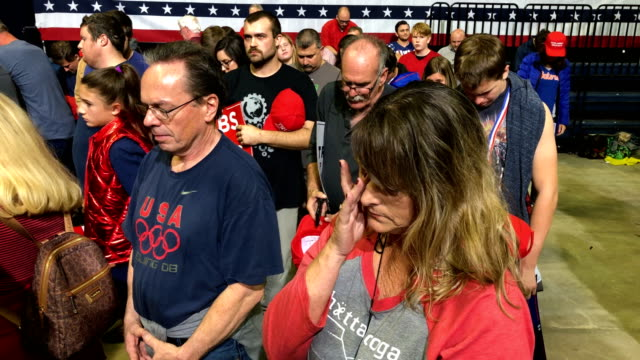 vídeos y material grabado en eventos de stock de supporters participate in a prayer during a campaign rally for rep marsha blackburn and other tennessee republican candidates at the mckenzie arena... - participante
