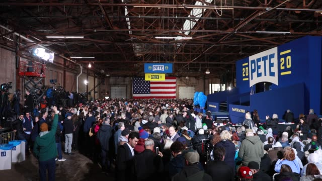 supporters wait in the cold and damp rain soaked studebaker factory for south bend mayor pete buttigieg to announce that he's running for president... - south bend indiana stock videos & royalty-free footage