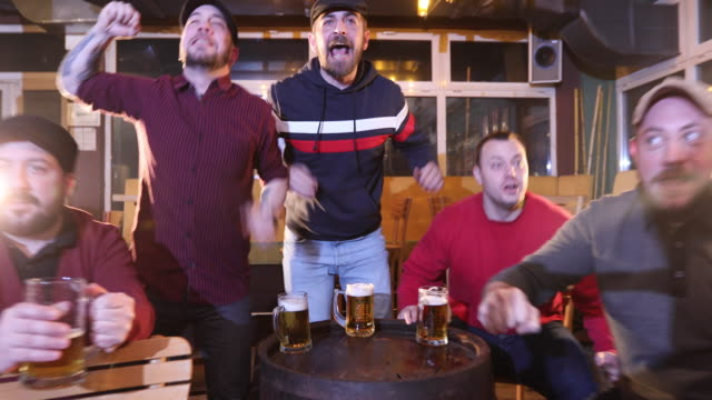 supporters watching a game in pub - toughness stock videos & royalty-free footage