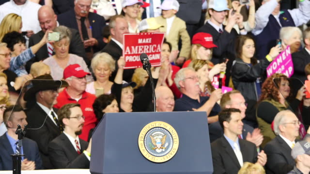 Supporters wave to United States President Donald Trump speaks after he spoke to 15000 of his supporters about repealing and replacing Obamacare and...