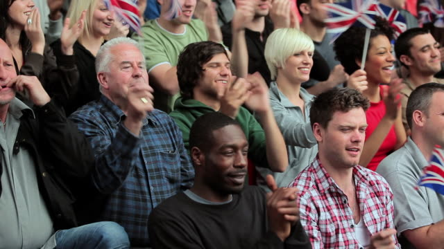 supporters waving british flags - whistling stock videos & royalty-free footage