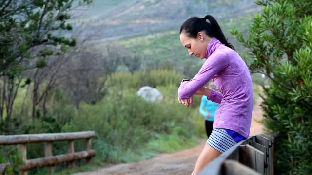 supporting my female running friend - timer stock videos and b-roll footage