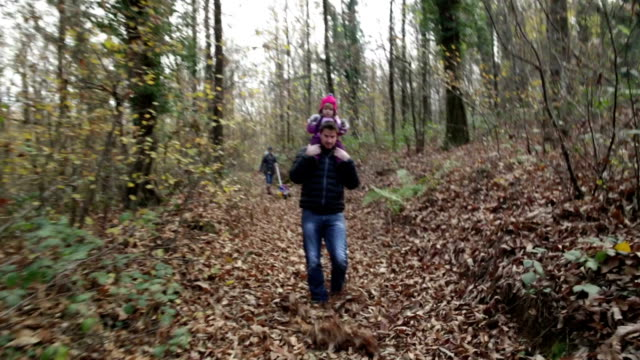 Supportive Dad and Little girl in Woods