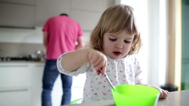 supportive dad little girl eats breakfast - genderblend stock videos & royalty-free footage
