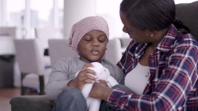 supportive mother holds child with cancer - cancer illness stock videos & royalty-free footage