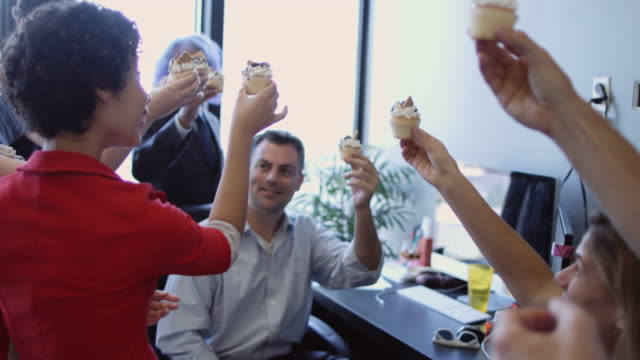 supportive office team sharing cupcakes - office politics stock videos & royalty-free footage