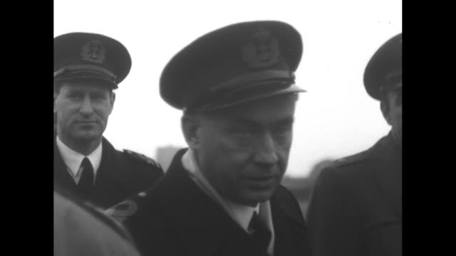 supreme allied commander europe matthew ridgway stopping with other officers to watch soldiers working / soldiers unloading gas cans from train car /... - matthew b. ridgway stock-videos und b-roll-filmmaterial