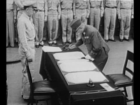 supreme commander for the allied powers gen. douglas macarthur watches signing of the japanese instrument of surrender / general jonathan wainwright... - newsreel stock videos & royalty-free footage