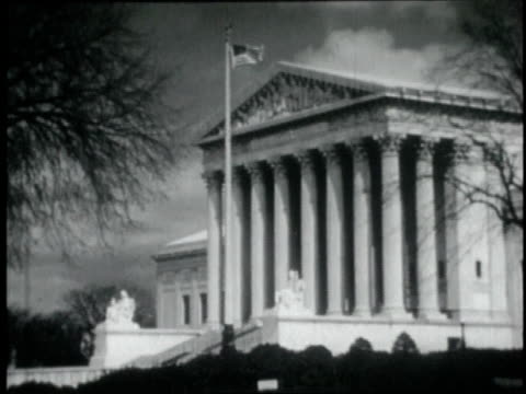 1946 MONTAGE Supreme Court Building with flag waving in front / Washington D.C., United States