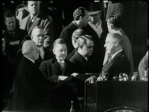 Supreme Court Chief Justice Charles Evans Hughes administers the Oath of Office to President Franklin D Roosevelt in 1941