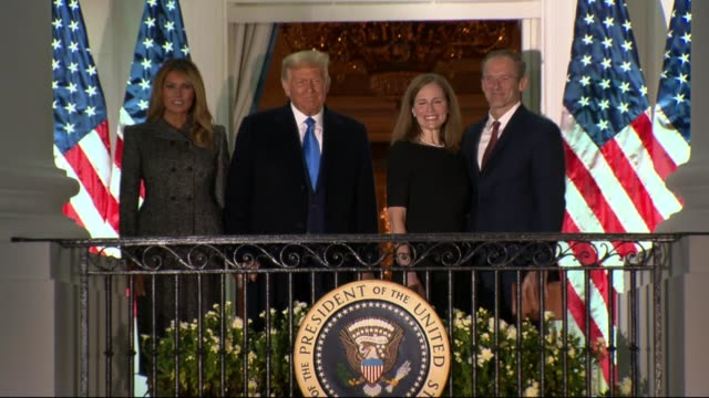 supreme court justice amy connie barrett stands beside president donald trump on the white house south balcony after taking the oath of office... - melania trump stock videos & royalty-free footage
