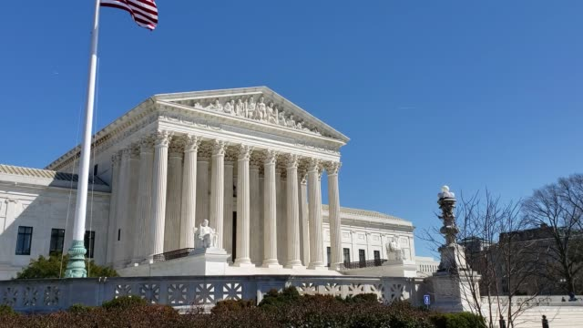 supreme court of the united states and american flag in washington, dc - supreme court stock videos & royalty-free footage