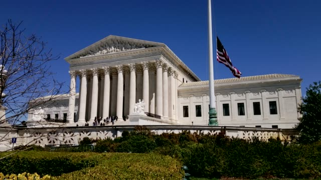 Supreme Court of the United States and American Flag in Washington, DC