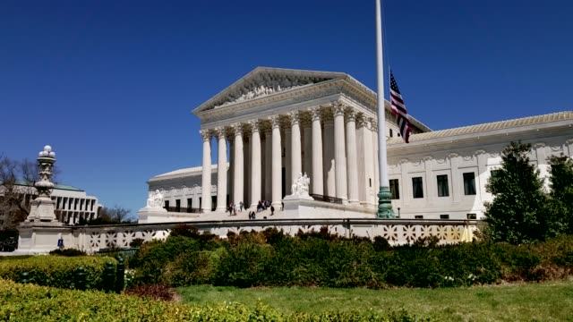 supreme court of the united states and american flag in washington, dc - us supreme court building stock videos & royalty-free footage
