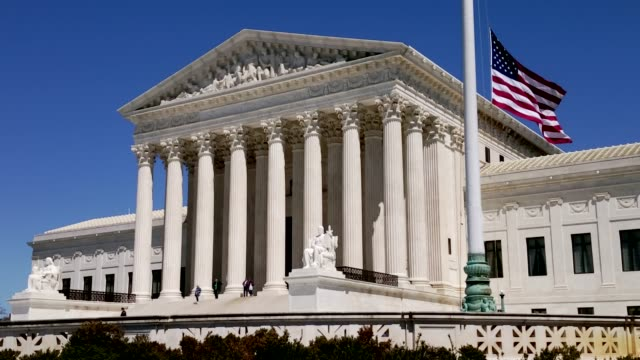 supreme court of the united states and american flag in washington, dc - equal arm balance stock videos and b-roll footage