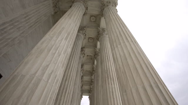 supreme court of the united states columns tilt down in washington, dc - supreme court stock videos & royalty-free footage