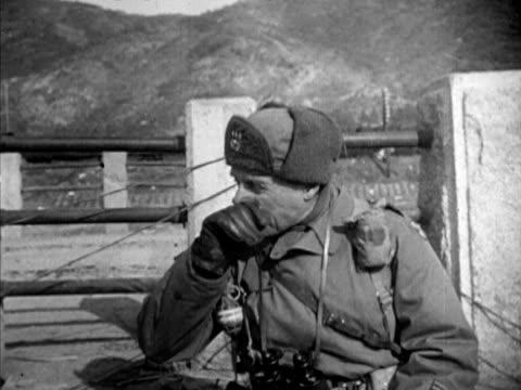 change of command ms supreme un and us commander in korea lieutenant general matthew ridgway using binoculars at fence standing between two... - matthew b. ridgway stock-videos und b-roll-filmmaterial