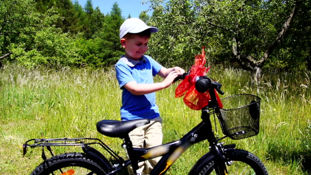suprised baby boy and bicycle gift - gift stock videos & royalty-free footage