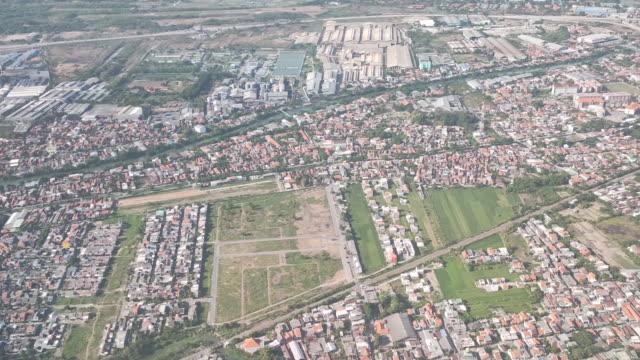 surabaya city from airplane. - surabaya stock videos & royalty-free footage