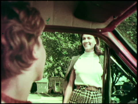 a surburban mom pulls into her friend's driveway to pick up the kids for pee wee football her friend is impressed by her new rambler classic station... - youth baseball and softball league stock videos and b-roll footage