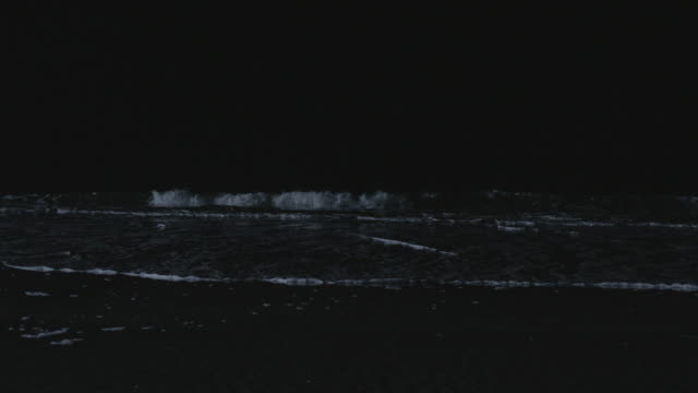 ms surf breaking on the beach at night - north carolina beach stock videos & royalty-free footage
