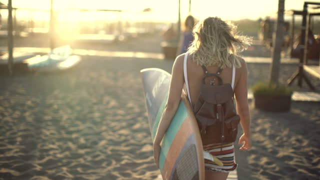 surf girl walking - surfboard stock videos and b-roll footage