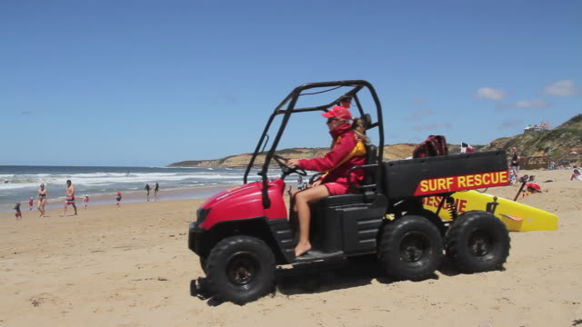 ms surf lifesavers using surf rescue boards and dune buggy / melbourne, victoria, australia - dune buggy stock videos and b-roll footage