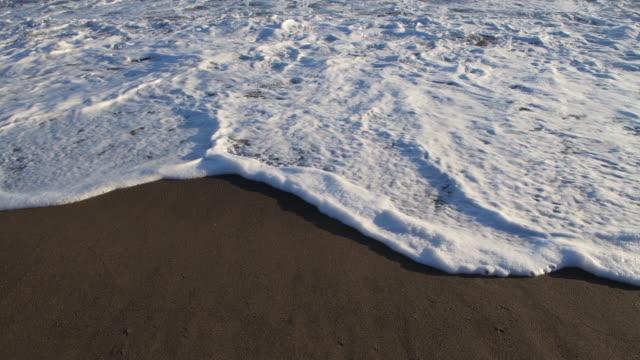 surf on sandy la tejita beach (playa de la tejita), close up. playa de la tejita, el medano, tenerife, atlantic ocean, canary islands, spain, atlantic islands. - atlantic islands stock videos & royalty-free footage