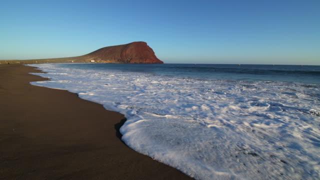 Surf on sandy La Tejita beach (Playa de la Tejita), close up. Playa de la Tejita, El Medano, Tenerife, Atlantic Ocean, Canary Islands, Spain, Atlantic Islands.