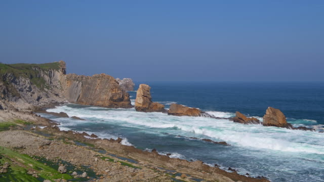 Surf on the rocks of Playa de La Arnia beach near Liencres. This area is called Costa Quebrada.