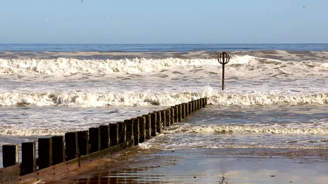 surf waves and groyne on aberdeen beach - aberdeen scotland stock videos & royalty-free footage