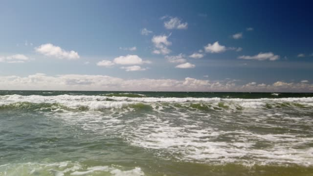 surf waves on the beach of sylt - wellen am strand von sylt - tina terras michael walter stock videos & royalty-free footage
