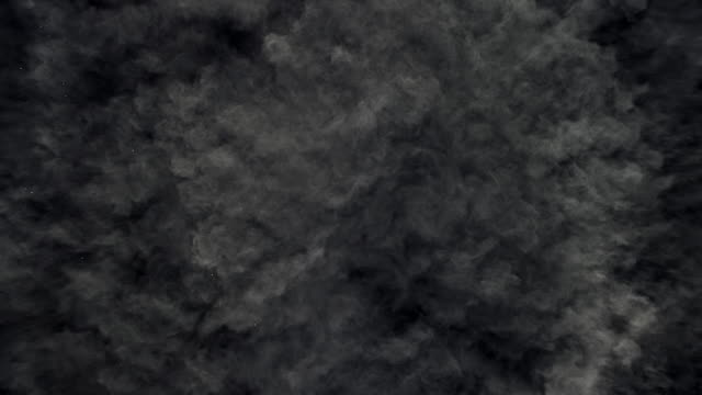 a surface filled with charcoal grey colored powder blasting towards camera and bouncing smoky texture in close up and super slow motion - mystery stock videos & royalty-free footage
