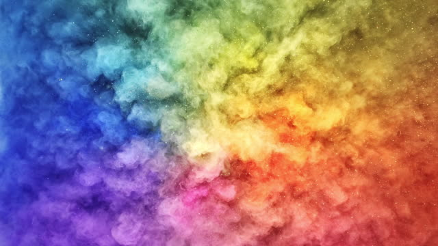 a surface filled with colorful powder blasting towards camera and making smoky texture in close up and super slow motion - rainbow stock videos & royalty-free footage