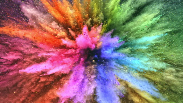 a surface filled with colorful powder blasting towards camera and making smoky texture in close up and super slow motion - bright stock videos & royalty-free footage