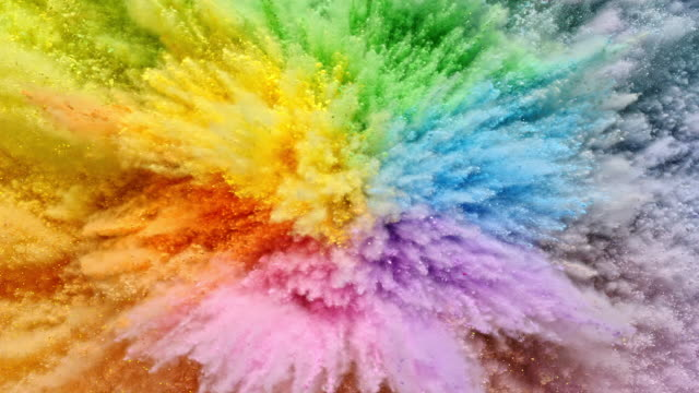 a surface filled with colorful powder blasting towards camera and making smoky texture in close up and super slow motion - pastel stock videos & royalty-free footage