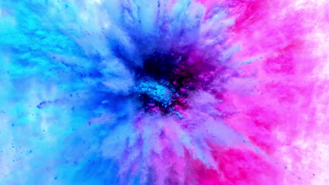 a surface filled with half blue and half pink powder blasting towards camera and blending into purple smoky texture in close up and super slow motion - role reversal stock videos & royalty-free footage