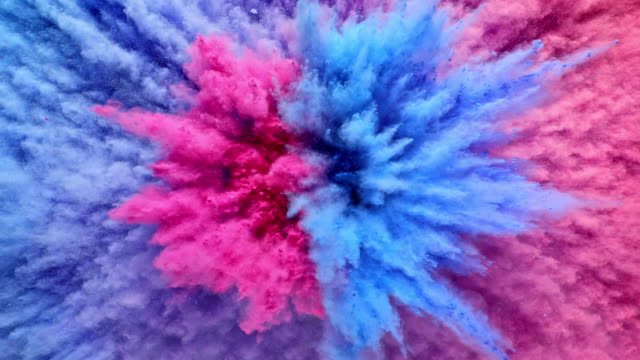a surface filled with half blue and half pink powder blasting towards camera and creating smoky texture in close up and super slow motion - make up stock videos & royalty-free footage