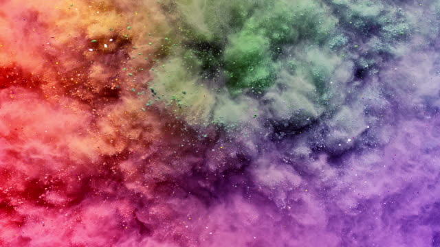 a surface filled with multi colored powder blasting towards camera and bouncing smoky texture in close up and super slow motion - pastel colored stock videos & royalty-free footage
