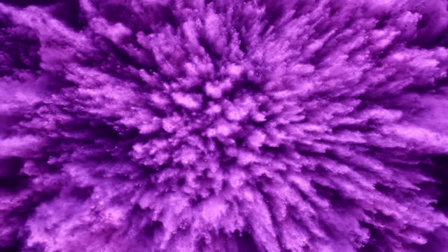 a surface filled with purple colored powder blasting towards camera and making smoky texture in close up and super slow motion - powder paint stock videos & royalty-free footage