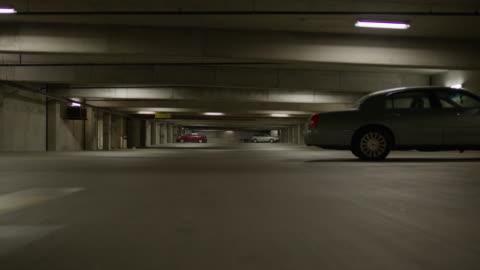 vídeos y material grabado en eventos de stock de surface level panning shot of cars in parking garage / provo, utah, united states - separación