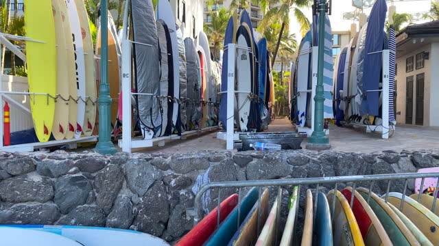 surfboards and fins for rental on beach in waikiki, honolulu, oahu, hawaii. - stack stock videos & royalty-free footage