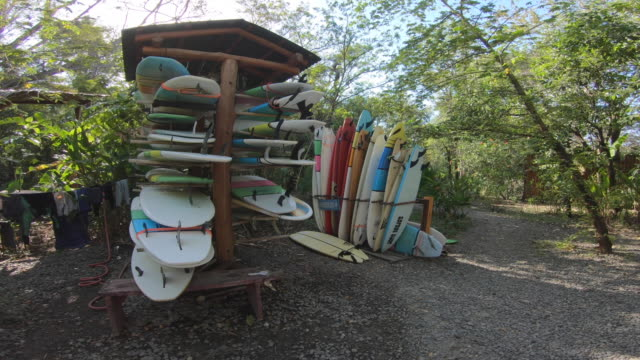 pov of surfboards on a rack. - slow motion - stack stock videos & royalty-free footage