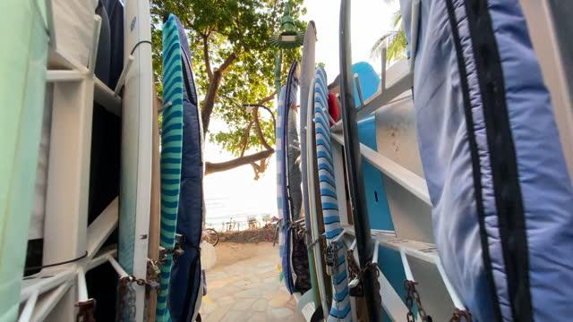 surfboards storage racks in waikiki, honolulu, oahu, hawaii. - slow motion - surfboard stock videos & royalty-free footage
