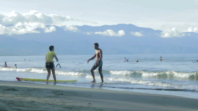 surfer at the beach - philippine sea stock videos & royalty-free footage