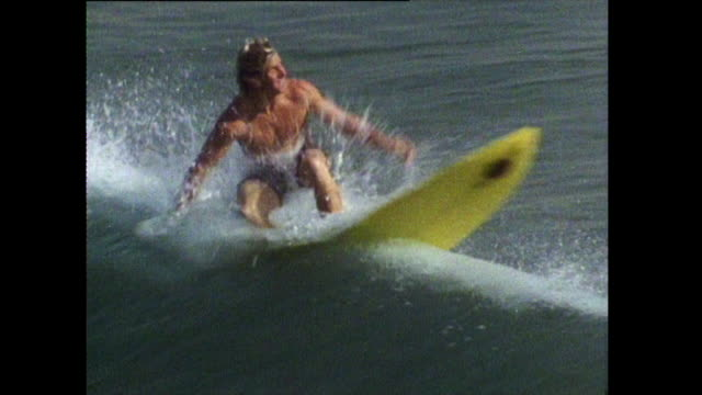 surfer catches waves on hermosa beach; 1972 - surf stock videos & royalty-free footage