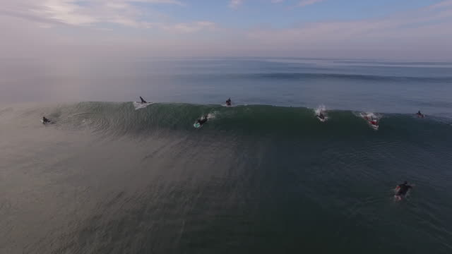 surfer catching wave wipeout, aerial, 4k, 8s, 124of133, surfing, beach, california coast, ocean, waves crashing, wipeout, crash, sea, action sports, epic, stock video sale - drone discoveries llc 4k sports - surfbrett stock-videos und b-roll-filmmaterial