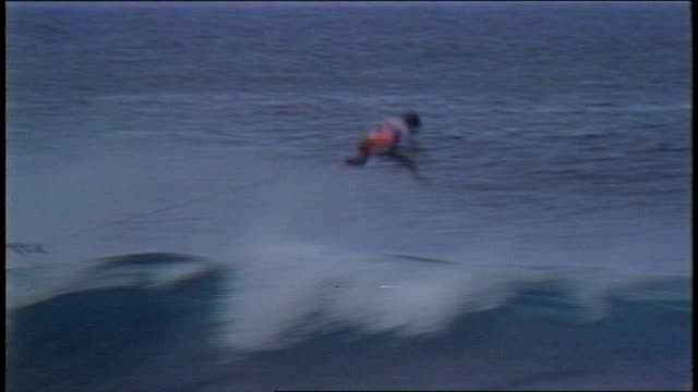 surfer flying off board over wave in pupukea hawaii - contestant stock videos & royalty-free footage