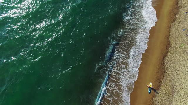 Surfer girl enjoys the waves 4K