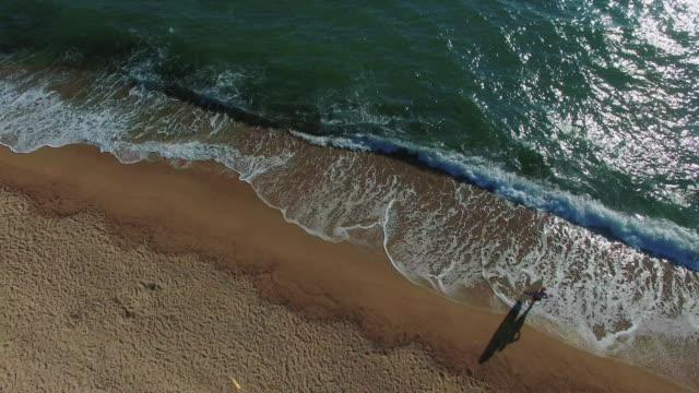 Surfer girl on the beach 4K